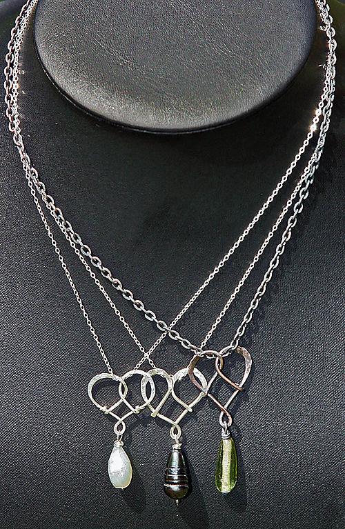 Trio of heart_tied necklaces