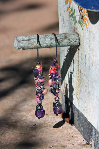 Fiber cocoon with amethyst dice on peg