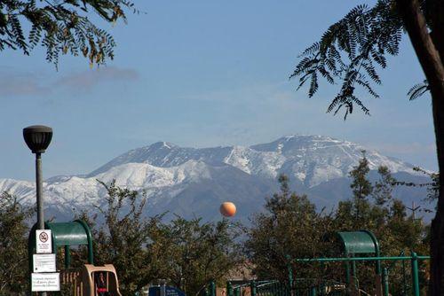 Snowy mountains with big orange balloon