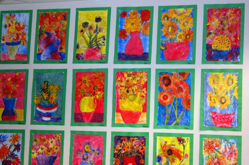 Finn's art class open house_7_22_09 wall of flowers