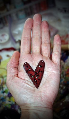 China pink enamel heart pendant in hand