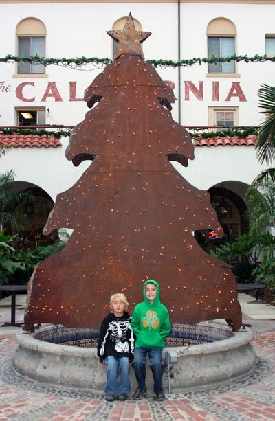Winterfest in fullerton_boys with tree sculpture