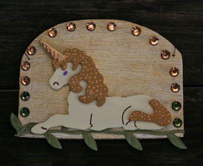 Glittering golden unicorn