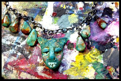 Green creature necklace