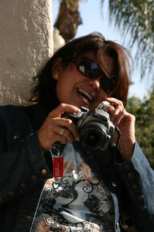 Ruth_with_camera_and_phone_1