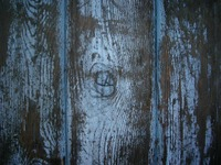 Blue_wooden_table_with_knothole